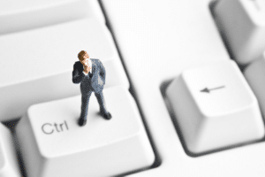 man on keyboard considering ISO 27001 misconceptions