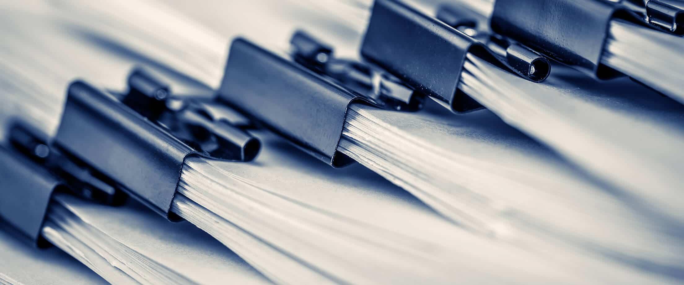 I photo of a set of ISO 27001 documentation