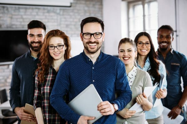 Portrait of successful young business team posing in office