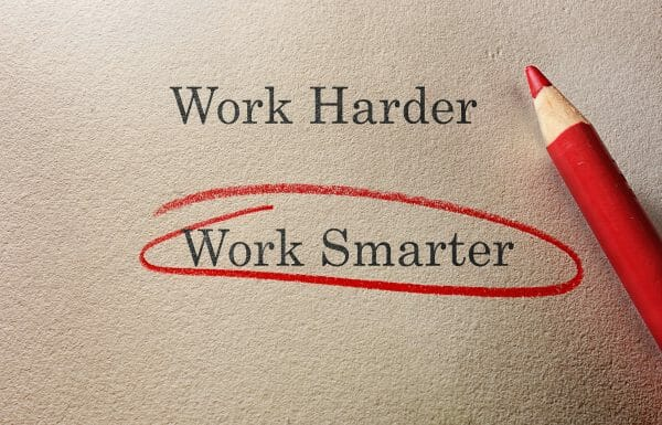 An imaged of two choices typed on a piece paper, Work Harder and Work Smarter. Work smarter has been circled with a red pencil.